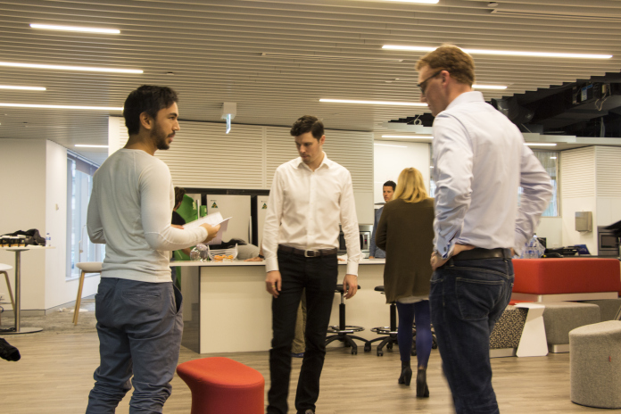 3 men discussing plans inside the Westpac Office
