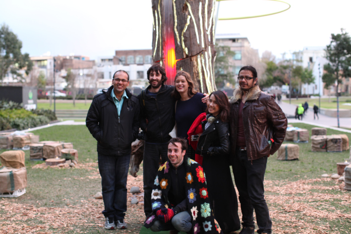Part of the S1T2 creative team standing infront of the Adobe Heart Tree