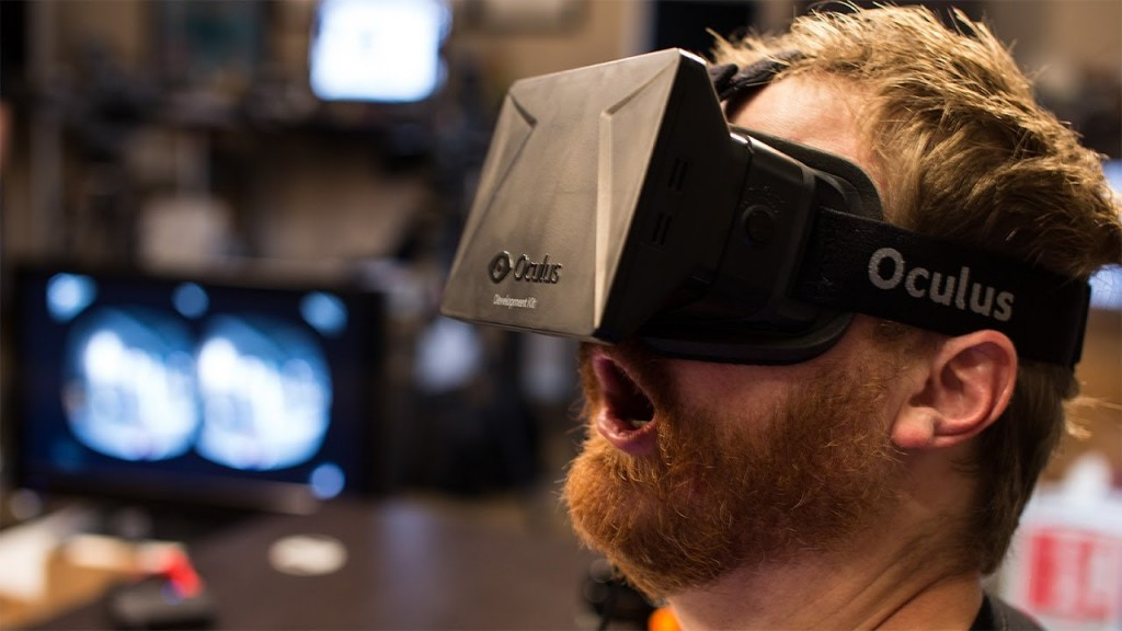 Man wearing Oculus Rift Goggles with gaping mouth