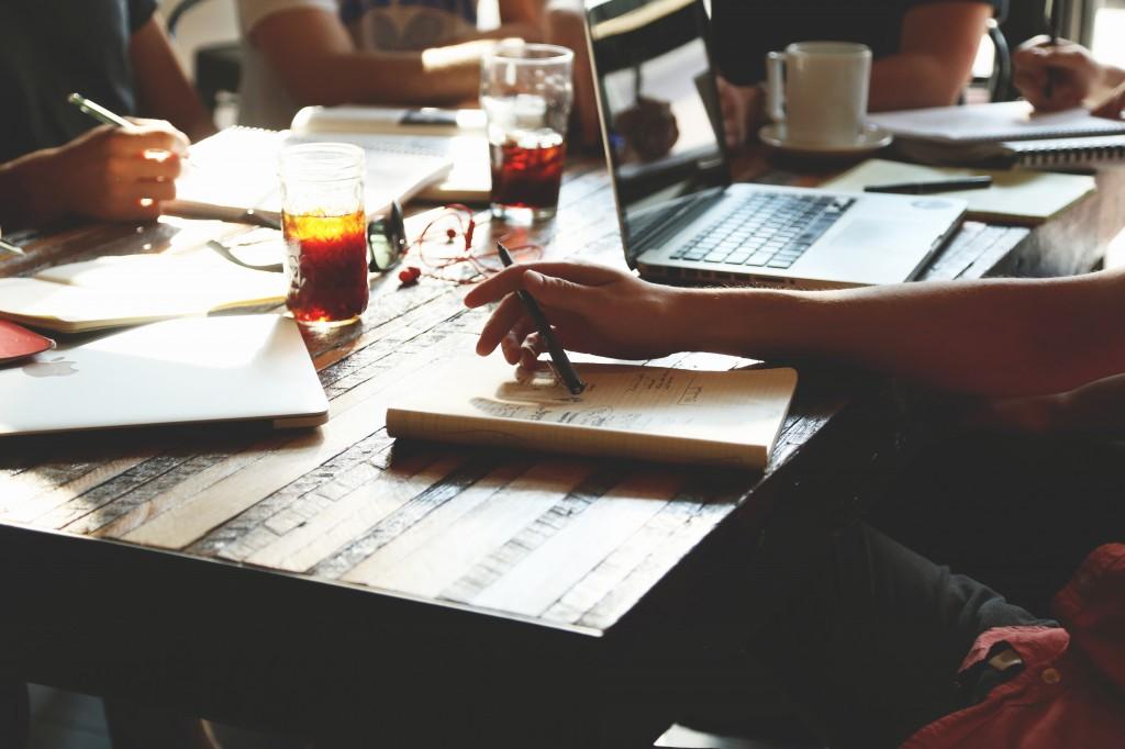 People brainstorming at coffee table