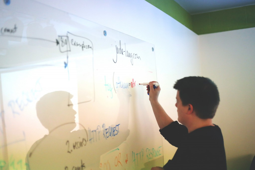 Man brainstorming on white board