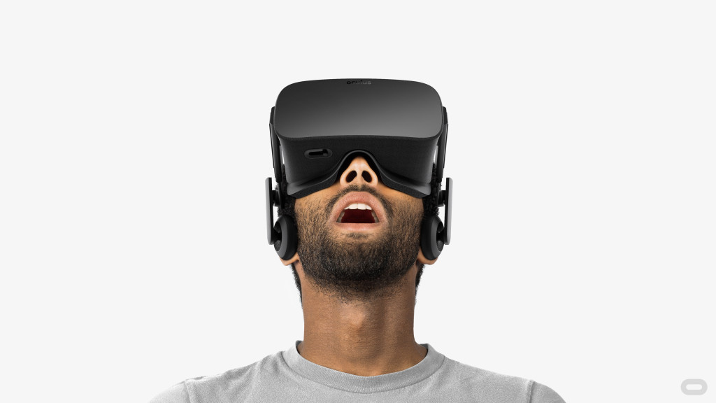 Person wearing Oculus Rift Virtual Reality headset with gaping mouth