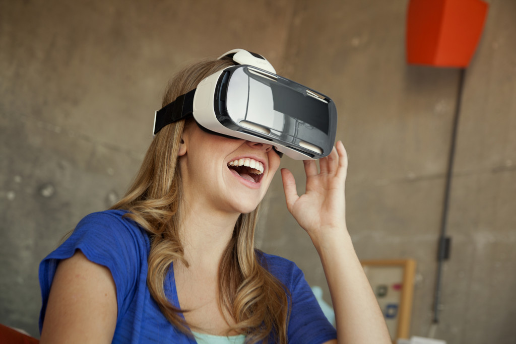 Girl wearing Samsung Gear Virtual Reality headset