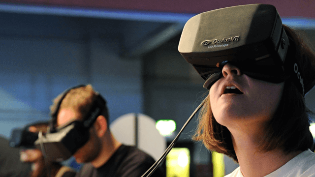 Girl experiencing Virtual Reality headset.