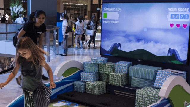 Girl playing on Real Time Interactive Floor.