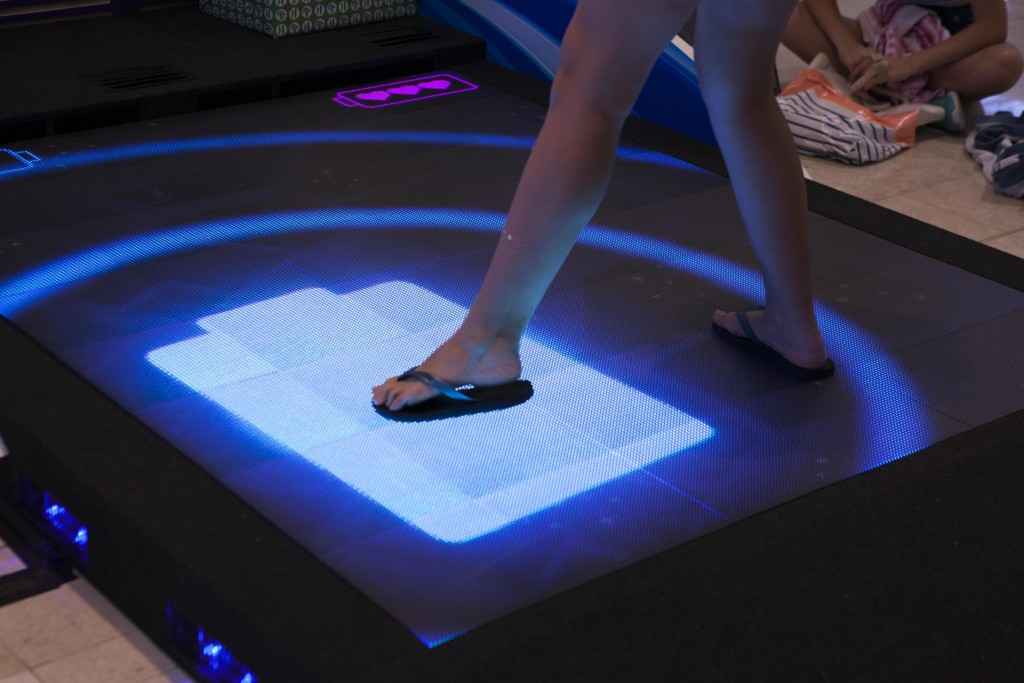 LED interactive floor with players feet interacting with game