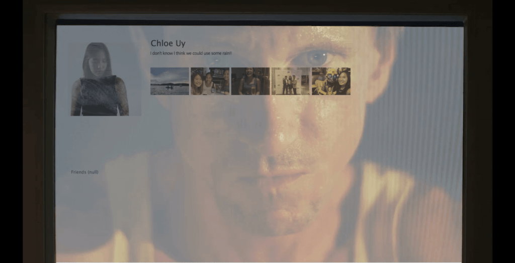 Computer Screen of girls profile with Man's face in reflection