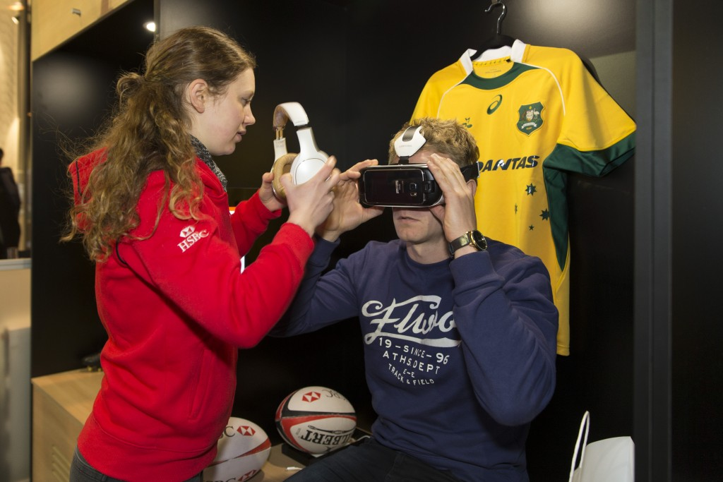 HSBC Wallabies player using Virtual Reality Goggles with team member