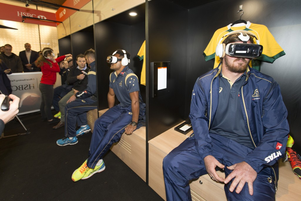 Various HSBC wallabies players wearing Virtual Reality Goggles in locker room