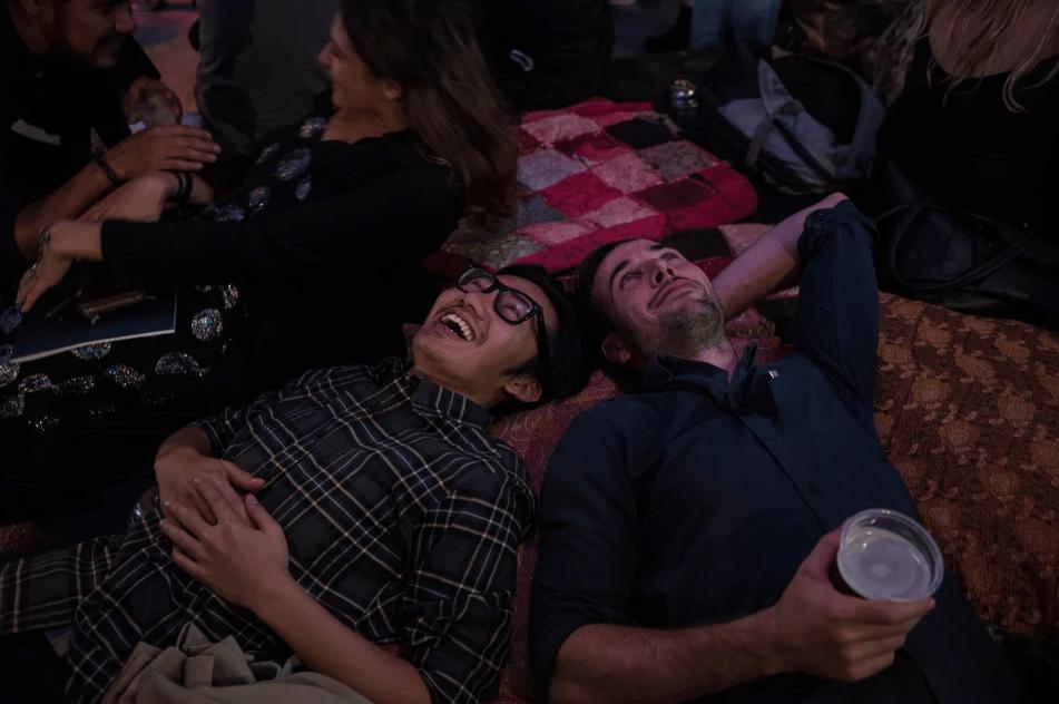 Users laying on the floor watching the Interactive Kaleidoscope Chandelier