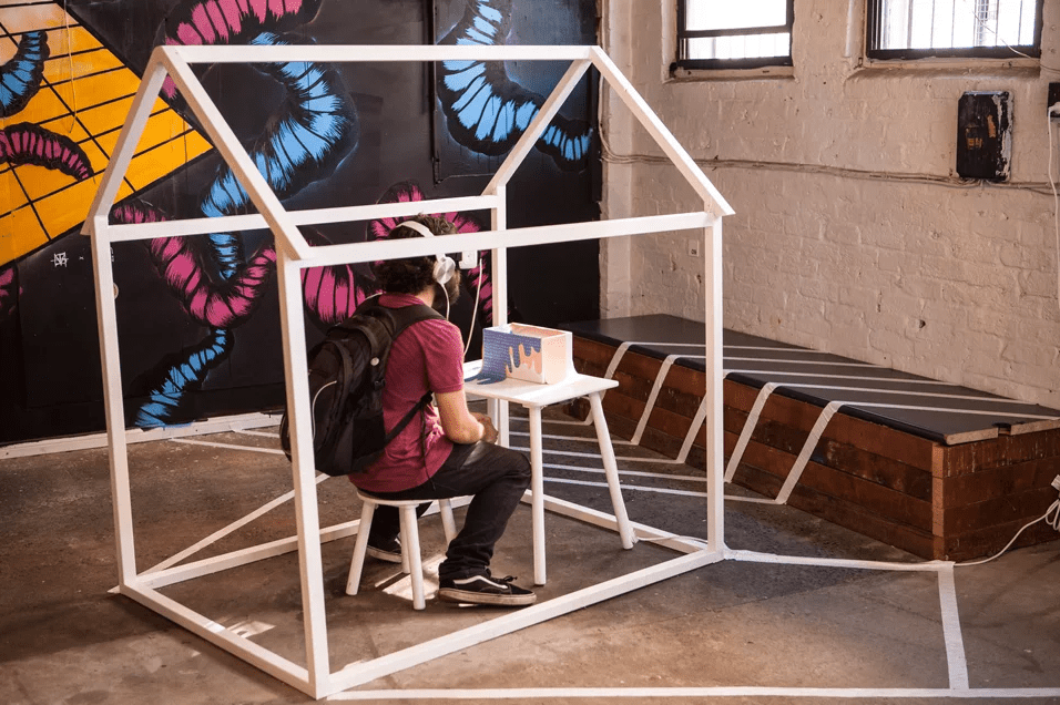 User participating inside a Virtual Reality dollhouse