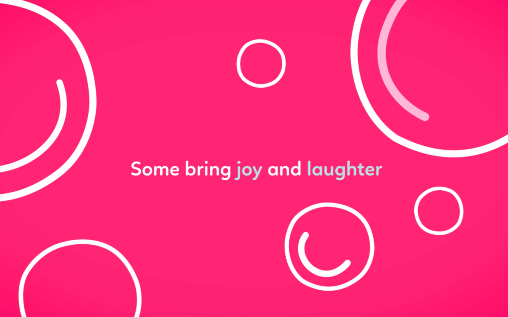 Pink still frame of joy and laughter in McGrath Foundation logo animation
