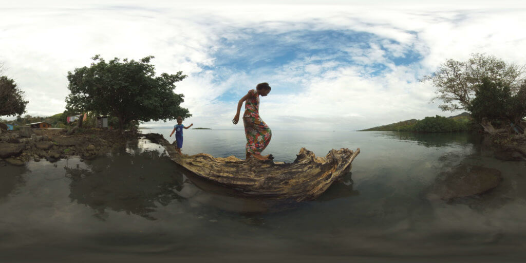 360 view of Fijian girls exploring a fallen tree near their home in the 'Our Home, Our People' virtual reality project