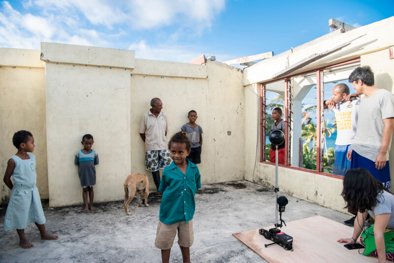 Fijian children wait behind the scenes of 'Our Home, Our People' virtual reality project
