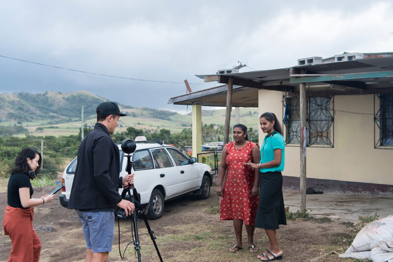 The director of 'Our Home, Our People' virtual reality film sets up a 360 shot in Rakraki, Fiji