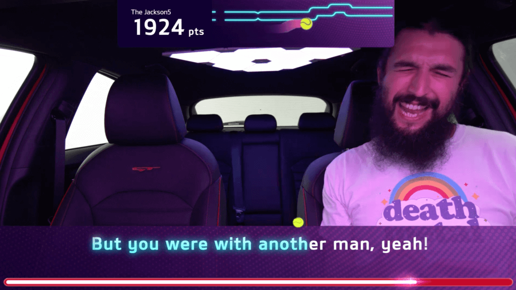 S1T2 team member tests the Kia Caraoke experience and game graphics