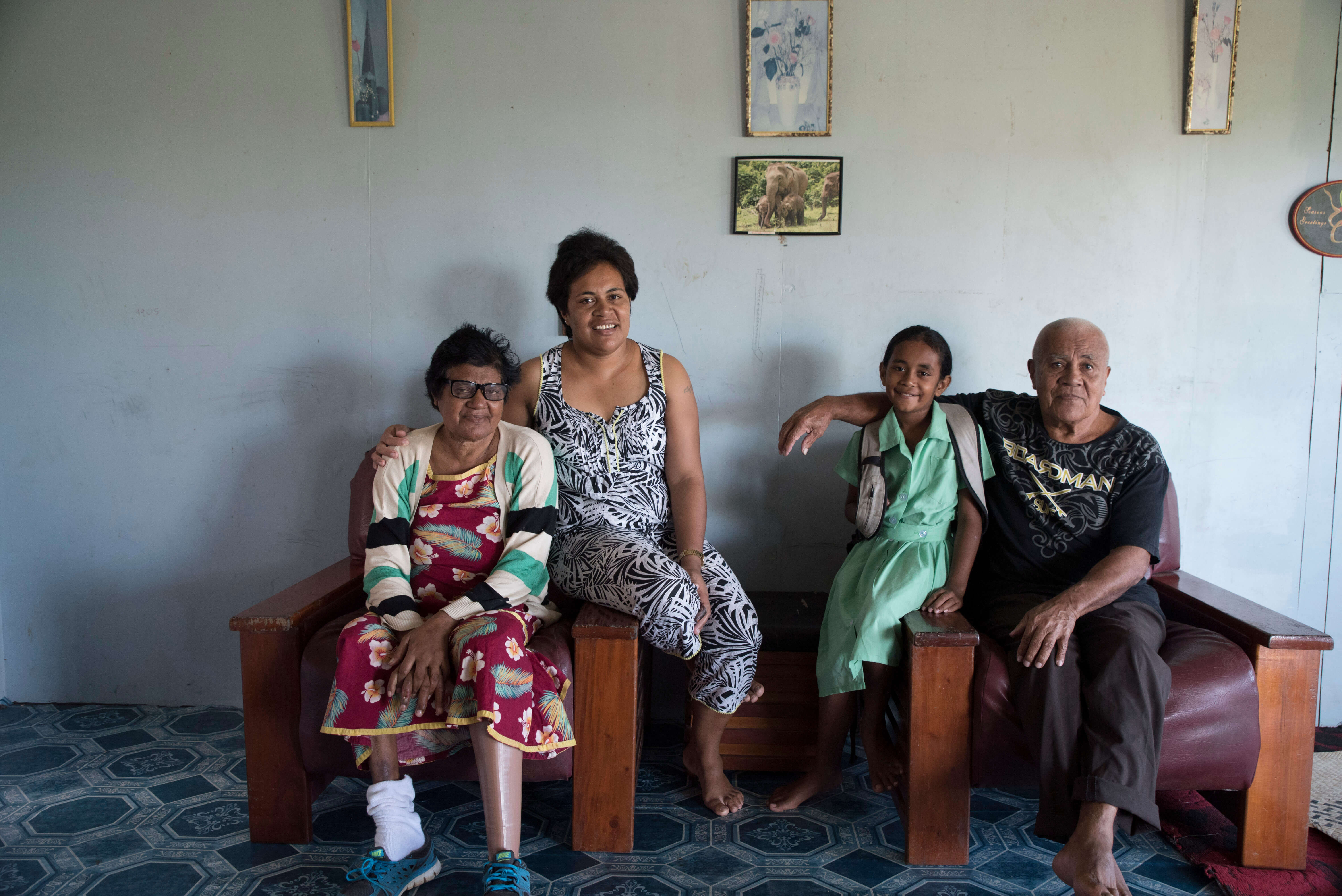 A Fijian family participating in Beyond the Stars sits for a portrait at their home in Nausori, Fiji.