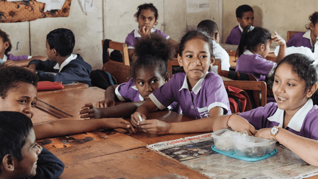 Fijian children who participated in the Beyond the Stars pilot eat lunch in their classroom.