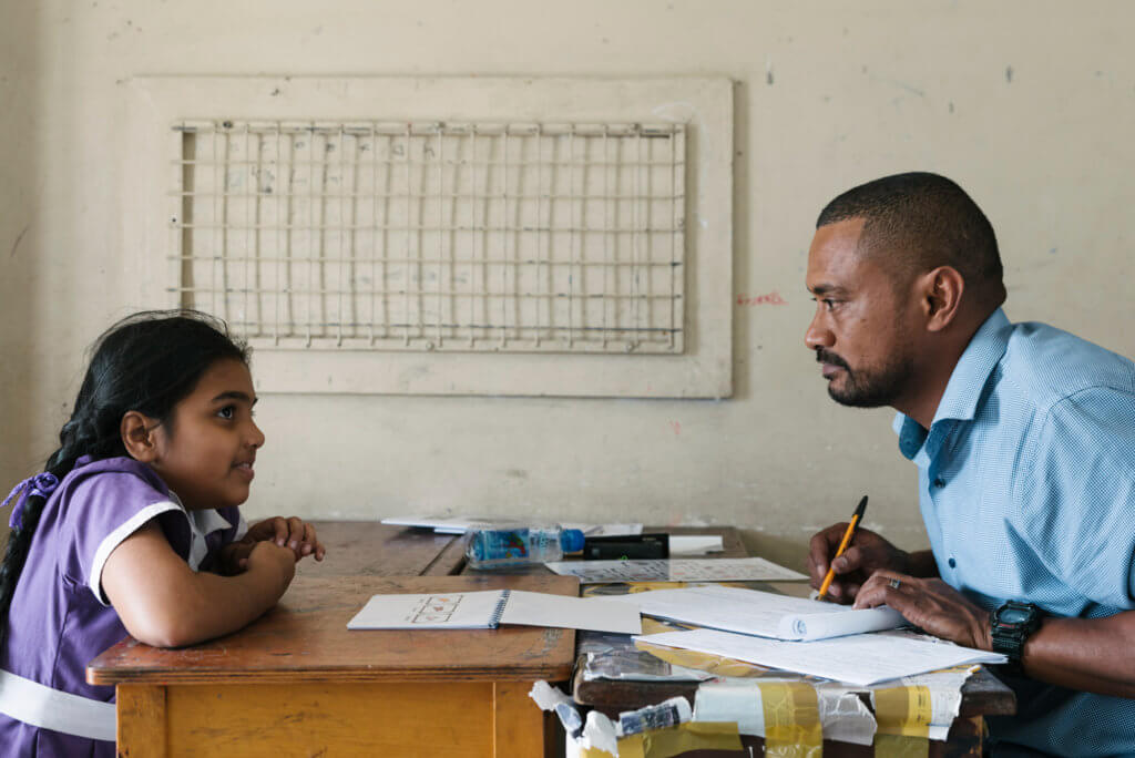 A member of the Beyond the Stars team conducts a child survey in Fiji