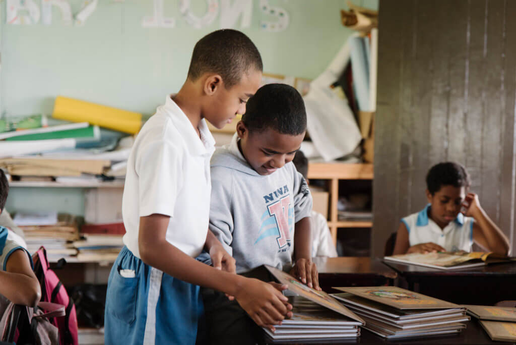 Two Fijian children use the Beyond the Stars program in class at a school in Viti Levu
