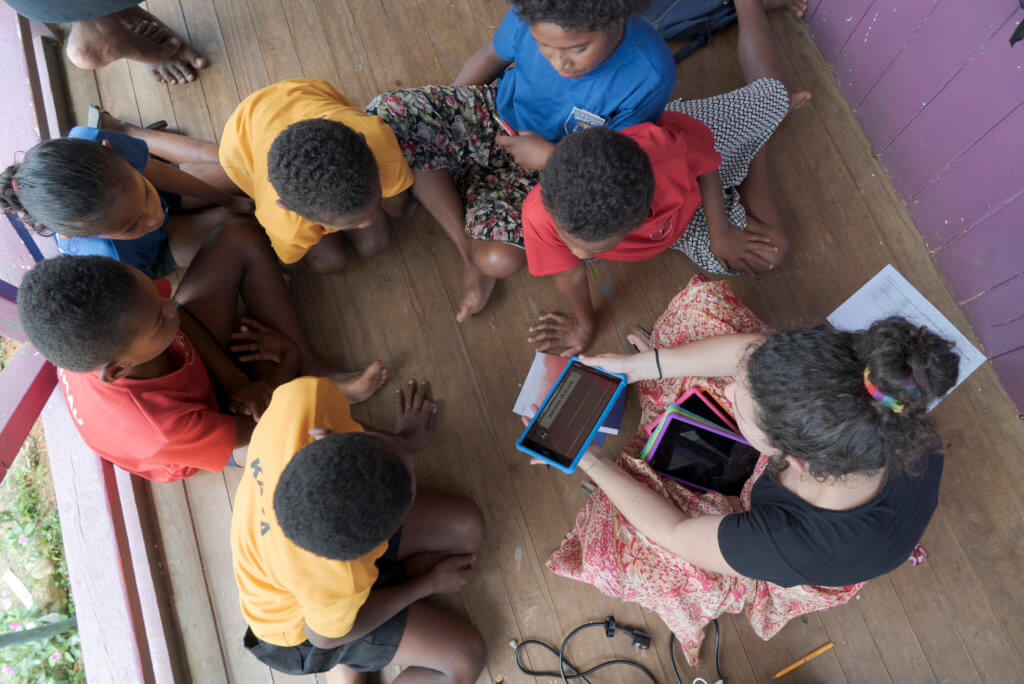 A group of Fijian children help test the Beyond the Stars Mobile game at a school in Viti Levu
