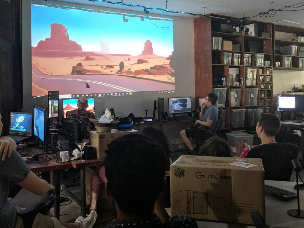 Explorer VR development team review progress on a projector