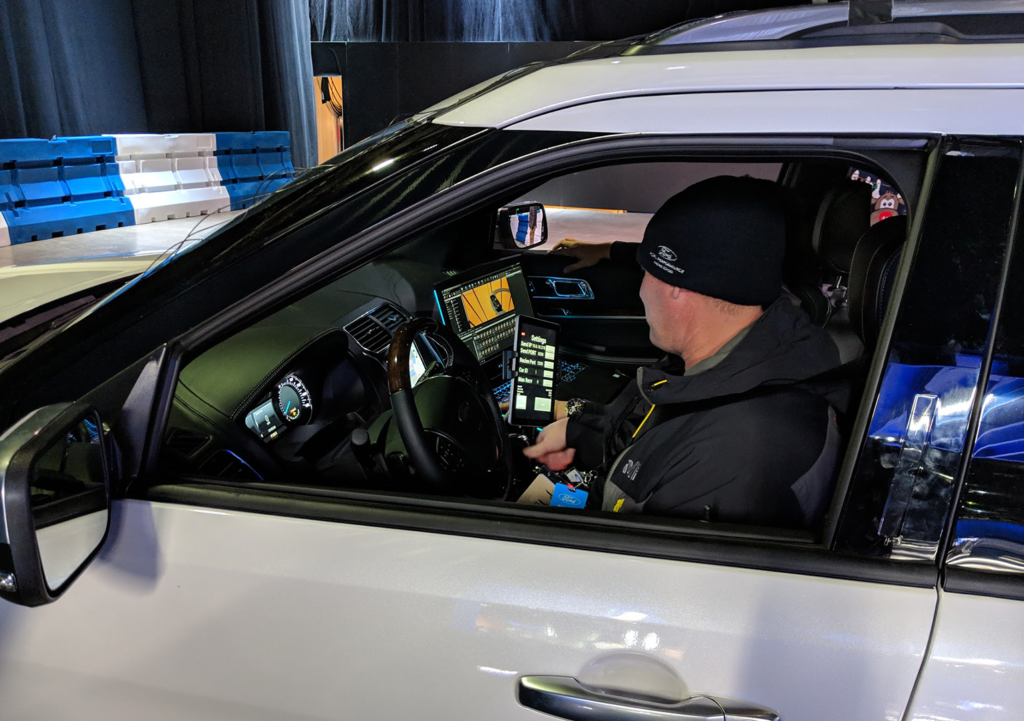 Professional driver uses a tracking app during the Ford Explorer VR experience