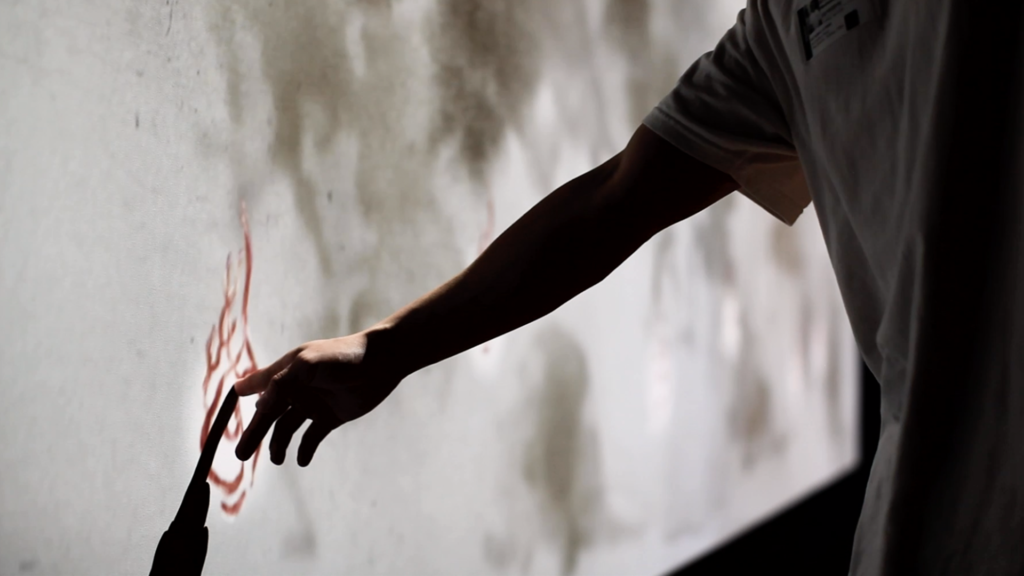 Man touches a flame animated interactive touch point made with conductive ink