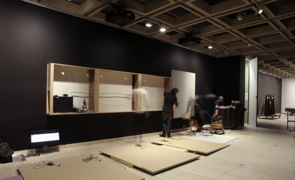 Time lapse photo of constructing the interactive touch wall for the Japan Supernatural exhibition