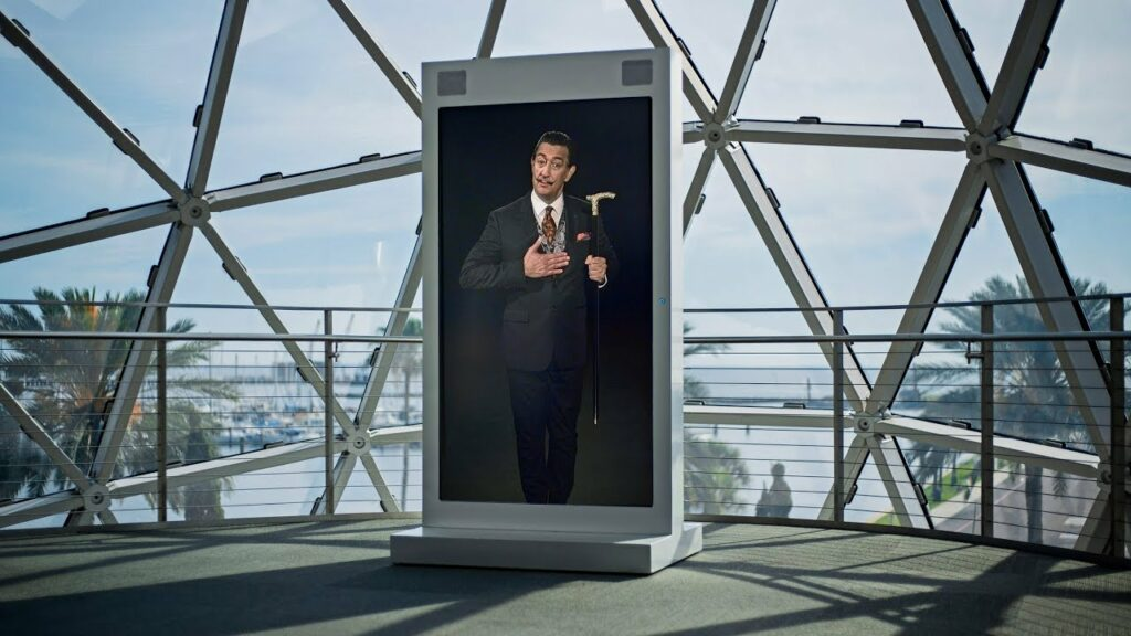Large screen shows a visualisation of Salvador Dali generated through artificial intelligence at the Dali Museum in Florida, USA
