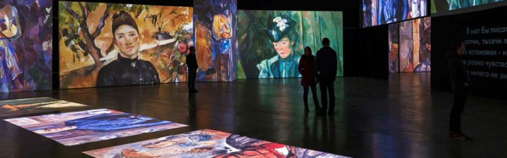 Two people admire Grande Exhibitions' high-definition projection artworks based on the French Impressionists
